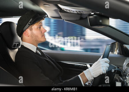 Portrait Of Young Chauffeur In Car - Stock Photo