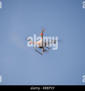 The drone, hovering in the sky. Flight quadrocopters - Stock Photo
