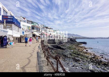 LANZAROTE, SPAIN -  7th Nov 2017: Tourists walk along the coast of Calle de La Chalana in  Playa Blanca. - Stock Photo