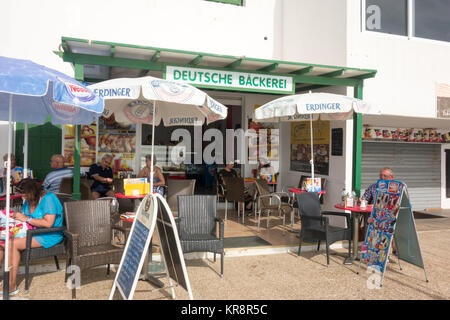 LANZAROTE, SPAIN -  7th Nov 2017: Tourists relaxes outside a German bakery shop called Deutsche Backere along Calle - Stock Photo