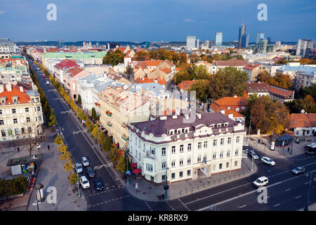 Lithuania, Vilnius, Old architecture of town with skyscrapers in background - Stock Photo