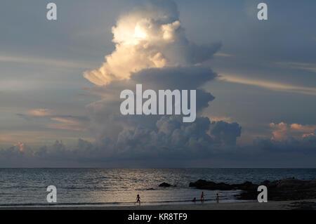 Towering cumulonimbus cloud at sunset in Malaysia - Stock Photo