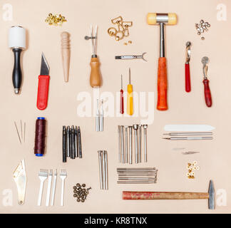 collection various leather crafting tools - Stock Photo