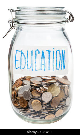 saved coins for education in closed glass jar - Stock Photo