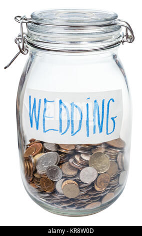 saved coins for wedding in closed glass jar - Stock Photo