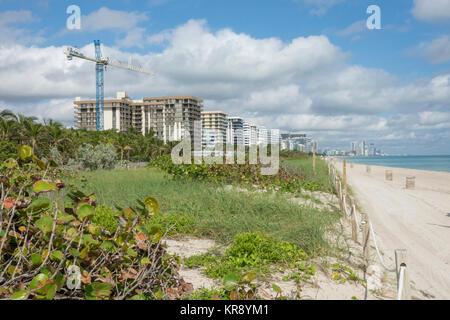 Construction boom crane and highrises at North Miami Beach, Florida - Stock Photo