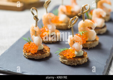 Shrimp Appetizer served on toasted bread - Stock Photo