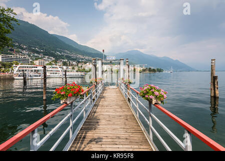 Locarno, Switzerland - May 28, 2016: Pier on the shore of lake Maggiore in Locarno, Switzerland. - Stock Photo