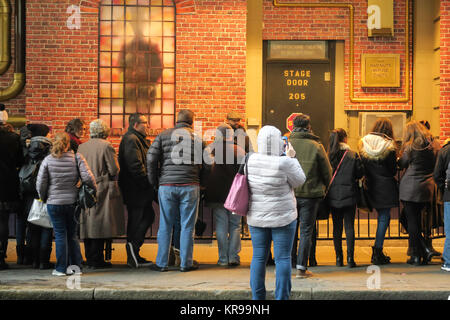 Fans Waiting Outside the Stage Door of the Lunt-Fontanne Theatre for Roald Dahl's Charlie and the Chocolate Factory, - Stock Photo