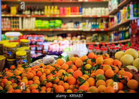 Citrus fruits in row with details. Blurred products in market store. Close up view. - Stock Photo