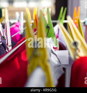 Colorful clothes pegs - Stock Photo