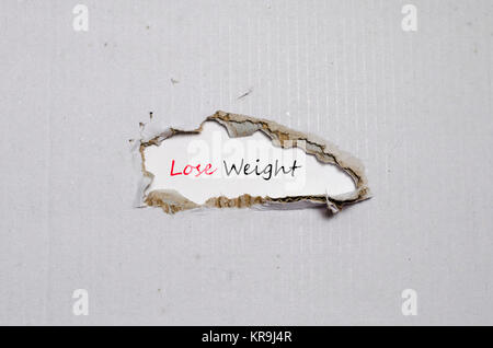 The word lose weight appearing behind torn paper - Stock Photo