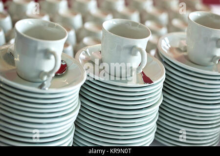 Coffee cups an plates in a restaurant - Stock Photo