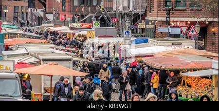 Hamburg, Germany, December 10th 2017: Market stalls and people at the fish market in Hamburg - Stock Photo