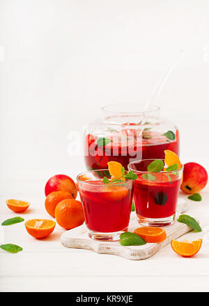 Sangria with fruits and mint on a white background - Stock Photo
