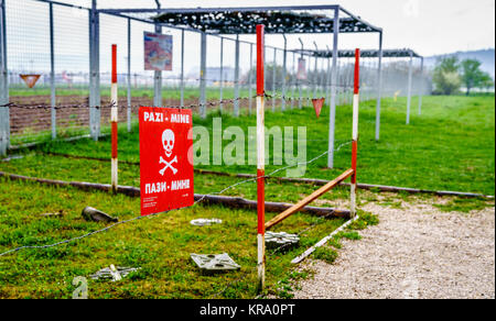 Old mine field sign as a leftover from the siege in Sarajevo, Bosnia - Stock Photo