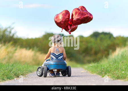 excursion with the pedal car - Stock Photo