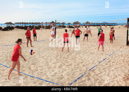 Tourists playing beach volleyball on Bikini Beach, Santa Maria, Sal Island, Salina, Cape Verde, Africa - Stock Photo