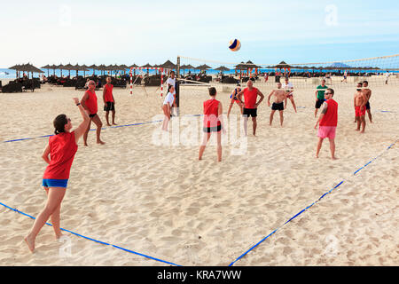 Tourists playing beach volleyball on Bikini Beach, Santa Maria, Sal Island, Salina, Cape Verde, Africa - Stock Photo
