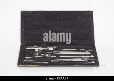 Set of precision technical drawing instruments in black case - Stock Photo