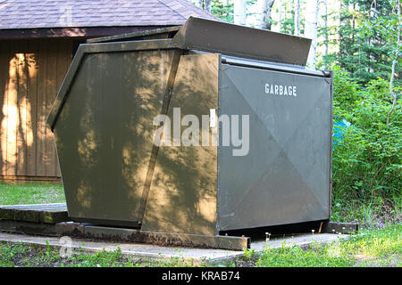 A large garbage bin at a campground. - Stock Photo