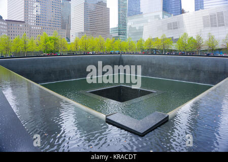 New York CITY, USA - May 01, 2016: Memorial at Ground Zero, Manhattan, commemorating the terrorist attack of September, - Stock Photo