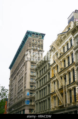 New York City, United States of America - May 02, 2016: The old residential buildings with fire escape stairs in - Stock Photo