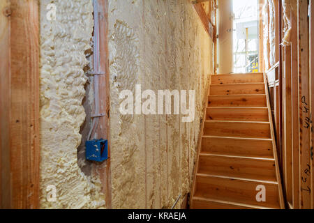 thermal and hidro insulation Inside wall insulation in wooden house, building under construction - Stock Photo