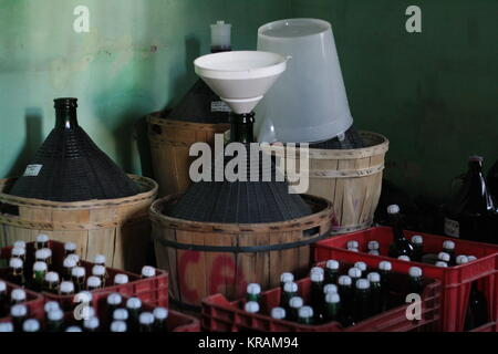 Demijohns Carboys and bottles in winery. - Stock Photo