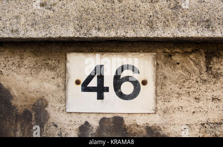 house home street number 46 a name plate design on brick wall in ...