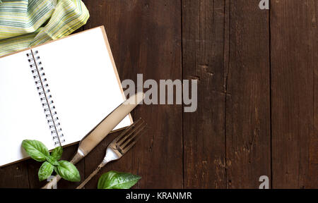 Blank cooking recipe book on a wooden table - Stock Photo