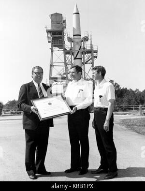 (C) Dr. Lucas, William-R, Director NASA-Marshall Space Flight Center, accepts Certificate of Registration from Madison - Stock Photo