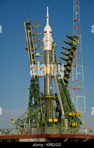 Large gantry mechanisms on either side of the Soyuz TMA-22 spacecraft are raised into position to secure the rocket - Stock Photo