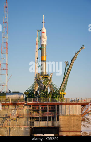 The Soyuz TMA-03M spacecraft is seen at the launch pad after being raised into vertical position on Monday, Dec. - Stock Photo