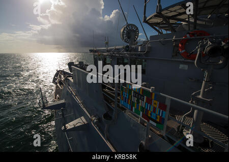 View looking southeast from the top of the USS Philippine Sea (CG 58) as it heads for the burial at sea service - Stock Photo