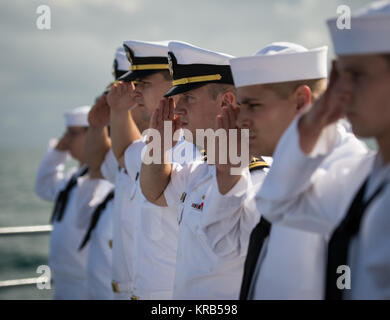 Members of the US Navy salute in honor of Apollo 11 astronaut Neil Armstrong during his burial at sea service aboard - Stock Photo