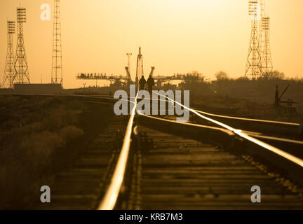 Russia security forces and their dog walk along the train track to the Soyuz launch pad, Tuesday, March 26, 2013 - Stock Photo