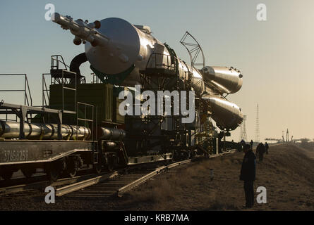 The Soyuz rocket is rolled out to the launch pad by train on Tuesday, March 26, 2013, at the Baikonur Cosmodrome - Stock Photo