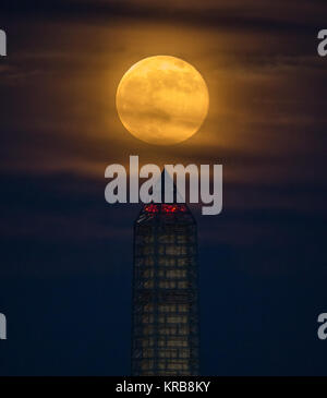 A supermoon rises behind the Washington Monument, Sunday, June 23, 2013, in Washington. This year the Supermoon - Stock Photo