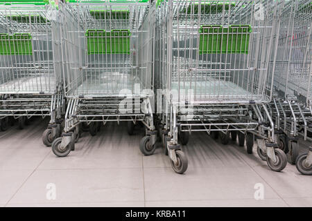 Shopping carts in a supermarket, detail of metal carts in a supermarket, - Stock Photo