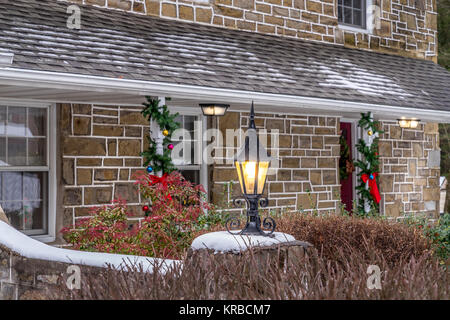 Illuminated outdoor lantern with white snow gives an extra charater for a holiday decor. Holiday concept. - Stock Photo