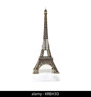 Paris Eiffel tower miniature on the marble stand isolated on white background - Stock Photo