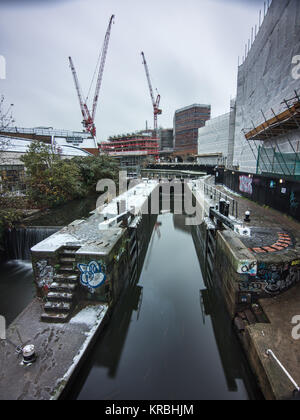 London, England, UK - December 10, 2017: New apartment buildings are under construction on old industrial land beside - Stock Photo