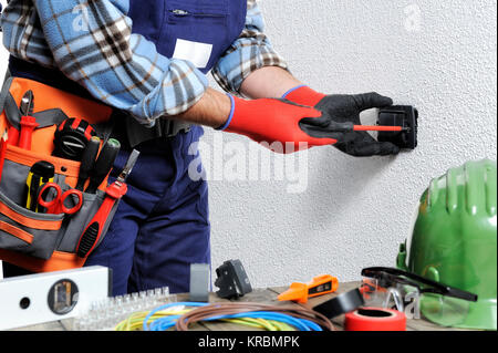 Electrician With Hands Protected By Gloves And Insulated Tools Works On A Residential Electrical Installation