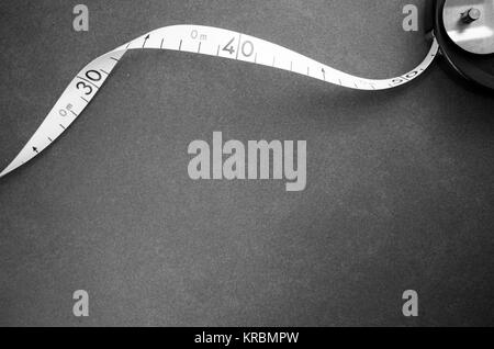 industrial metric measuring tape on a stone surface - top view - Stock Photo