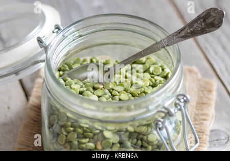 Green peas in a glass jar - Stock Photo