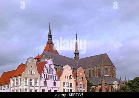 marienkirche and gabled houses on the neuer markt in rostock - Stock Photo
