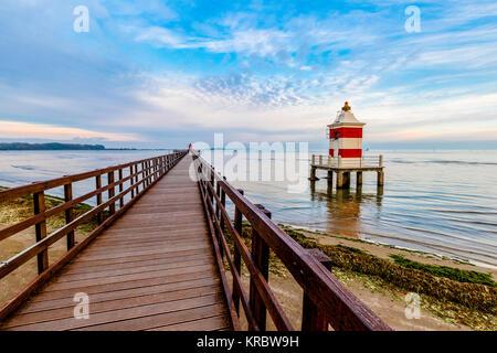 Italy Friuli Lignano Sabbiadoro Pier and red Lighthouse - Stock Photo