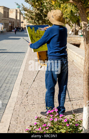 An Artist Painting In The City Of Bukhara, Uzbekistan - Stock Photo