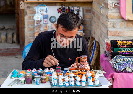 A Local Craftsman/Artist Working In The Market, Bukhara, Uzbekistan - Stock Photo